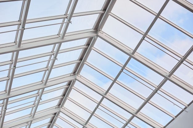 Roof of modern builduing. glass ceiling photographed from inside. shopping center. vintage contemporary architecture