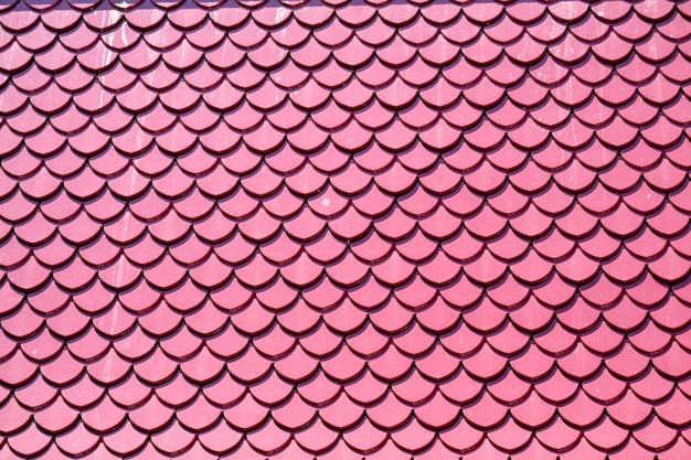 Roof tiles pink color design same fish scales