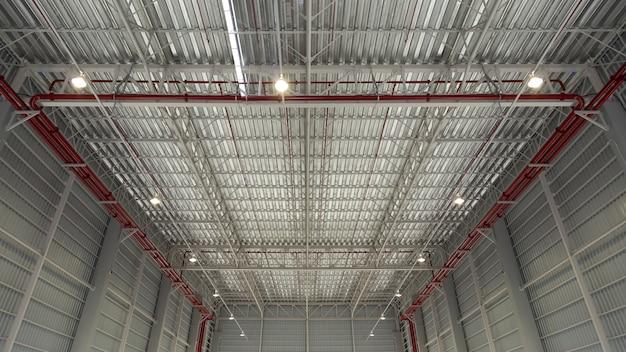 産業背景の屋上、工業ビルの屋根構造。屋根産業の構造。鉄骨構造と電球の背景と質感