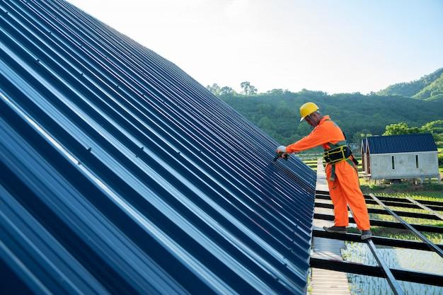 Roofer worker using air or pneumatic nail gun