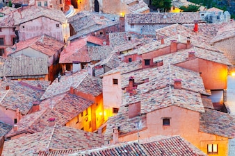 Roofs of spanish mountains town in evening
