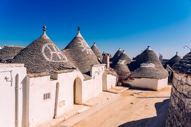 Roofs with symbols in the trulli, in the famous italian city of alberobello.