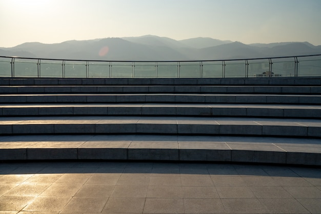 The rooftop patio stairway and mountain is background.
