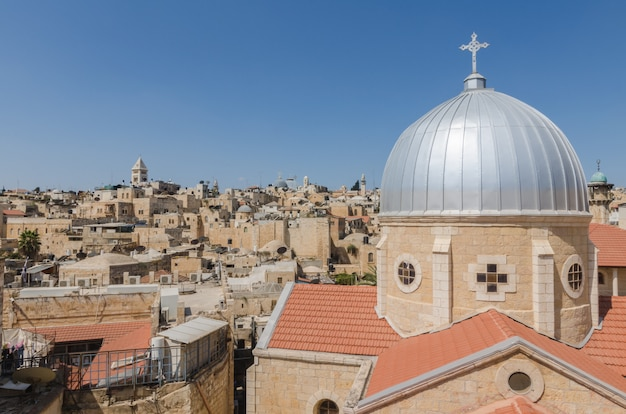 Rooftops of the old city of jerusalem, including the dome of our lady of spasm in the foreground