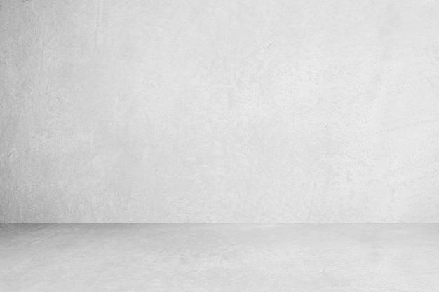 灰色の部屋のセメントまたはコンクリートの壁のテクスチャ背景と太陽光のあるセメントの床の空の部屋。