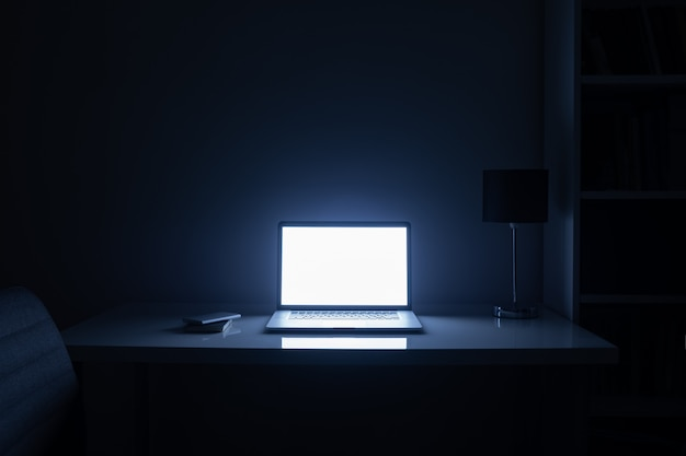 Room illuminated by a computer screen at night