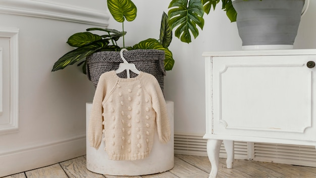 Room interior with knitted sweater
