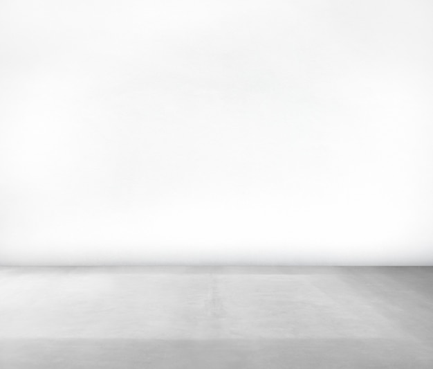 Stanza fatta di muro bianco e pavimento in cemento