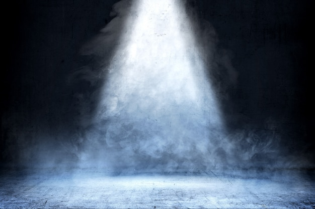 Room with concrete floor and smoke with light from the top, background