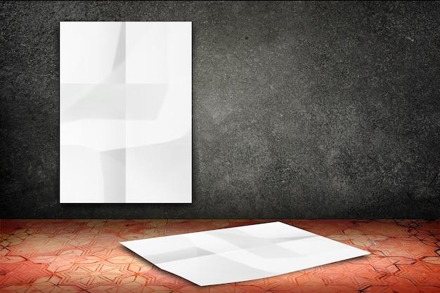 검은 돌 벽에 빈 구겨진 흰색 포스터와 빈티지 패턴 벽돌 바닥에 떨어지는 포스터 매달려 방