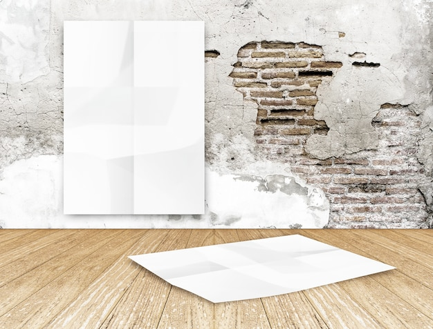Room with hanging blank crumpled white poster at crack brick wall and wooden floor room