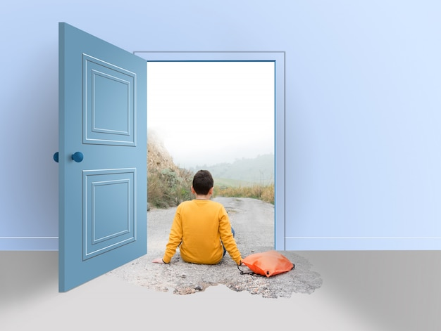 Room with open door. teenager sitting on the road, outside and inside the house