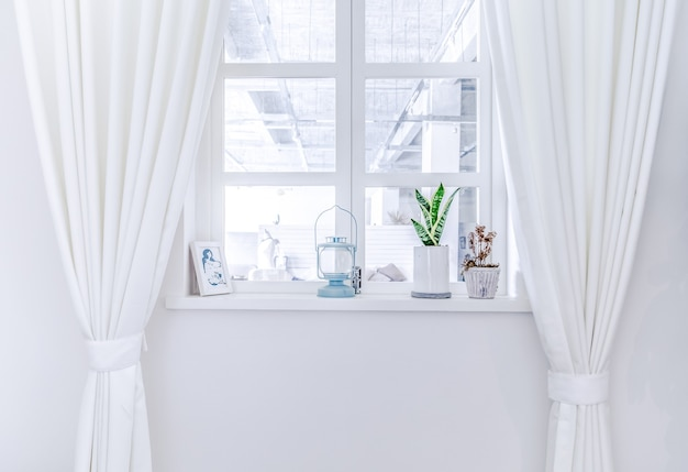 A room with white curtains