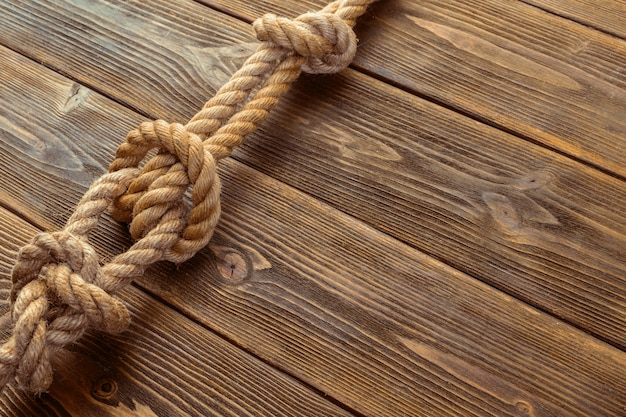 Rope knot on wooden board