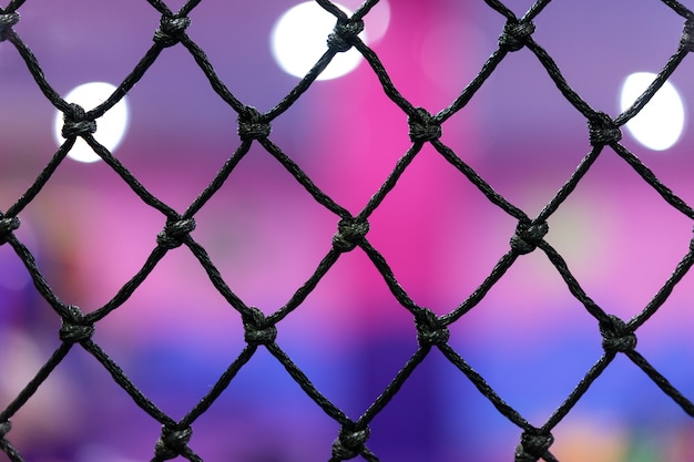 Rope mesh with blurry background in children playground