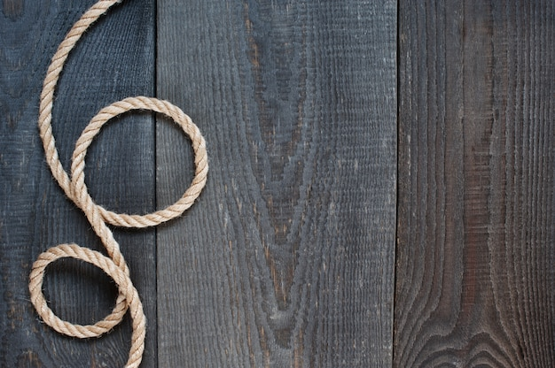 Rope on the old wooden background