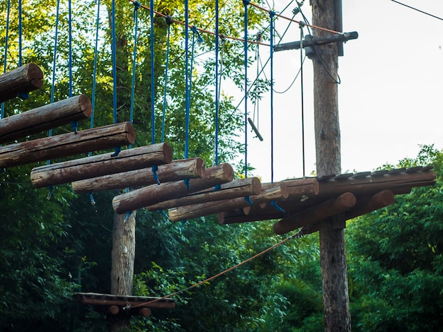 Rope park wooden bridge obstacle in the forest