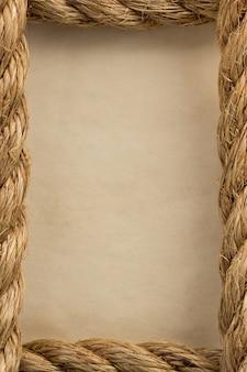 ロープと古いヴィンテージの古代紙の背景