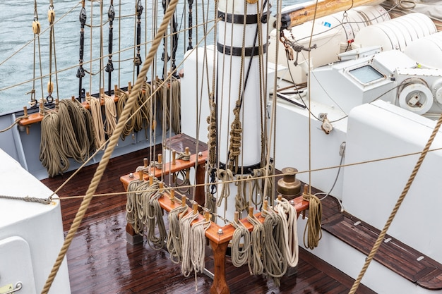 Ropes on the mast for sailing.
