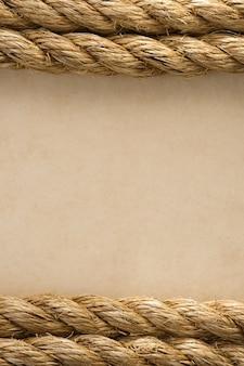 오래 된 빈티지 고 대 종이 배경 텍스처에 로프