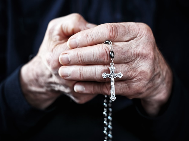 Rosary in a hand