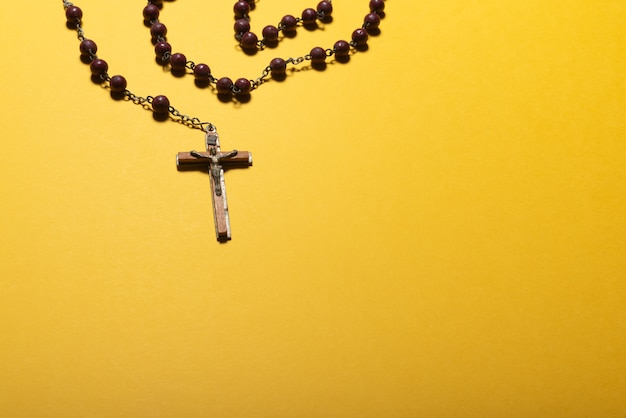 Rosary on yellow