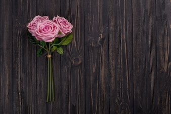 Rose bouquet on wooden tabletop