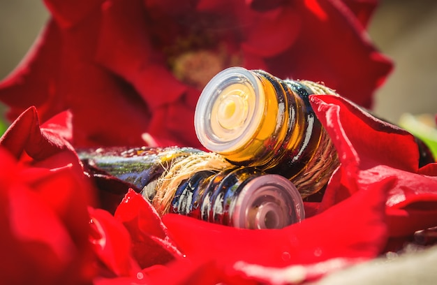 Rose essential oil in a small jar. selective focus.