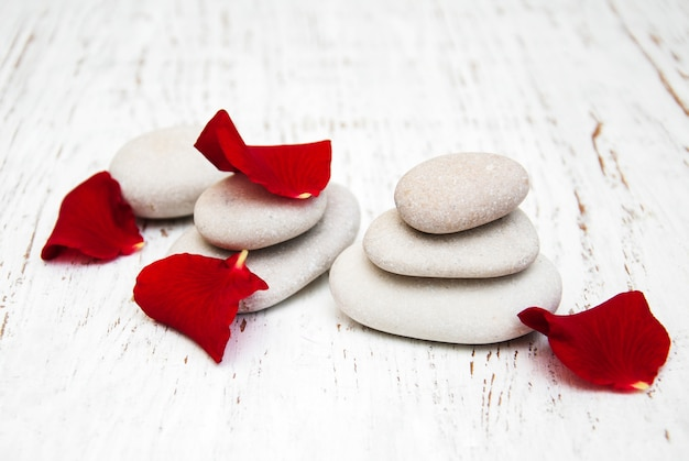Rose flower petals with massage stones