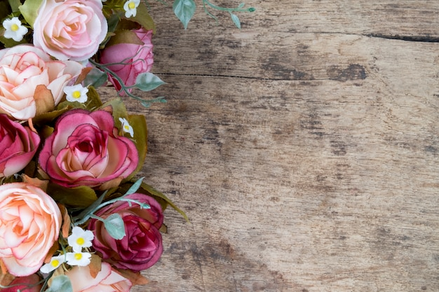 Rose flowers on rustic wooden background. copy space.