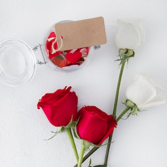 Rose flowers with blank tag on table