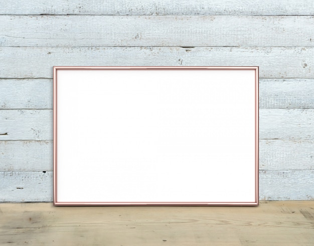Rose gold a4 horizontal frame stands on a wooden table
