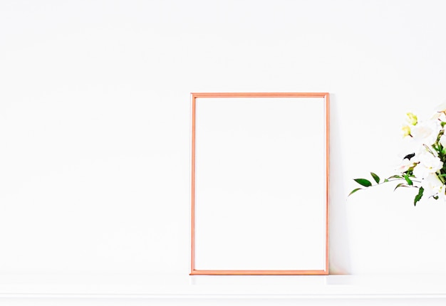 Rose gold frame on white furniture luxury home decor and design for mockup poster print and printabl...
