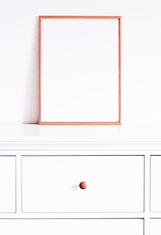 Rose gold frame on white furniture luxury home decor and design for mockup poster print and printable art online shop showcase