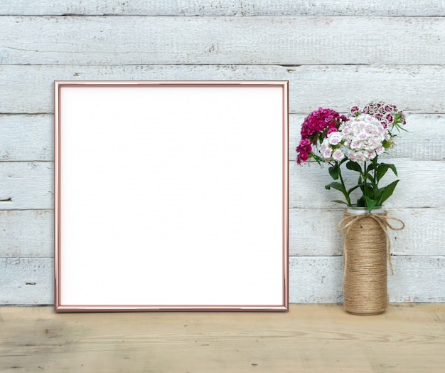 Rose gold square frame near a bouquet of sweet-william 3d render.