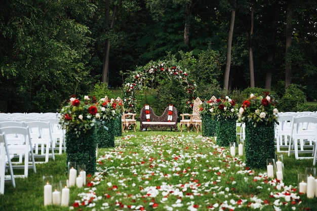 Rose petals cover green garden ready for traditional hindu weddi