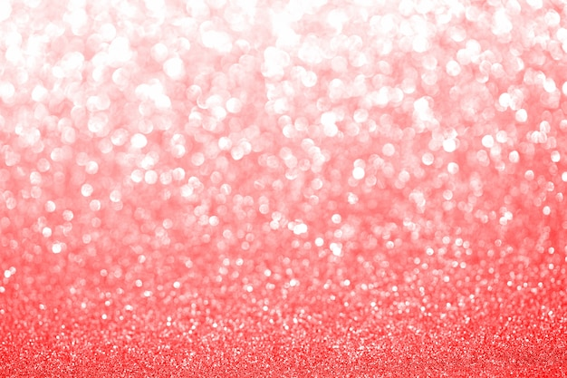 Rose pink and red blurred glitter background. sparkling and shiny texture for christmas or valentine's day holiday. seasonal wallpaper decoration