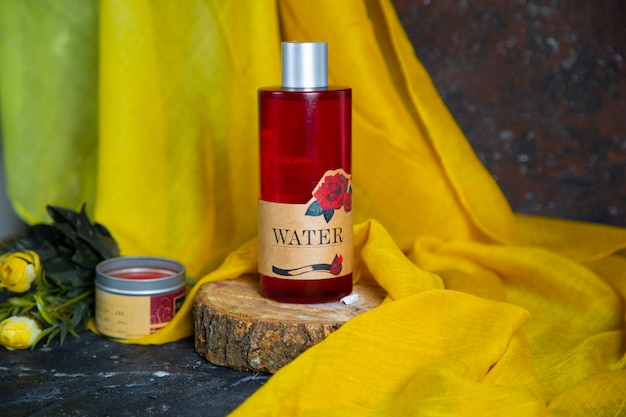 Rose red body lotion, spa cream, nourishing cream and massage oil bottle on a piece of wood.