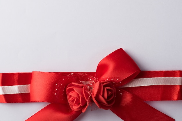 Rose ribbon with white paper