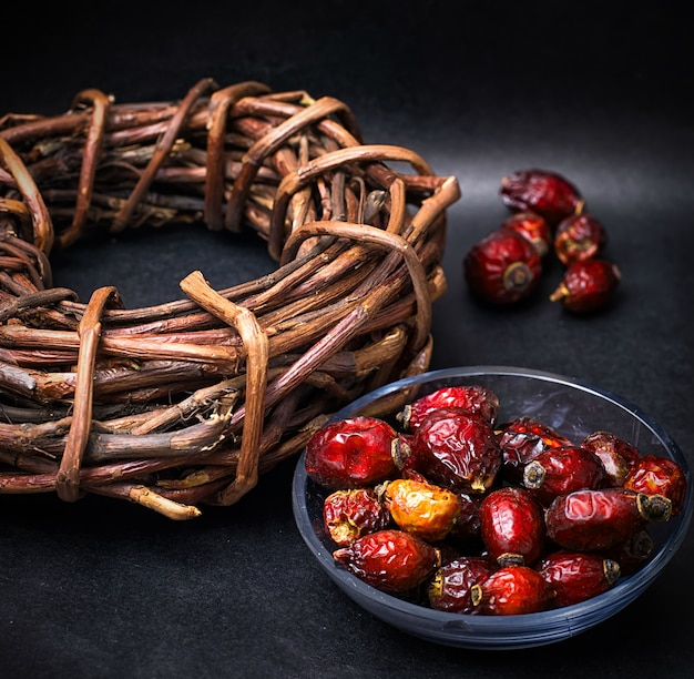 Rose in white bowl on background licorice root bound in coil