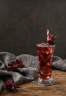 Roselle clear glass with fresh roselle fruit on wooden table asia recipe