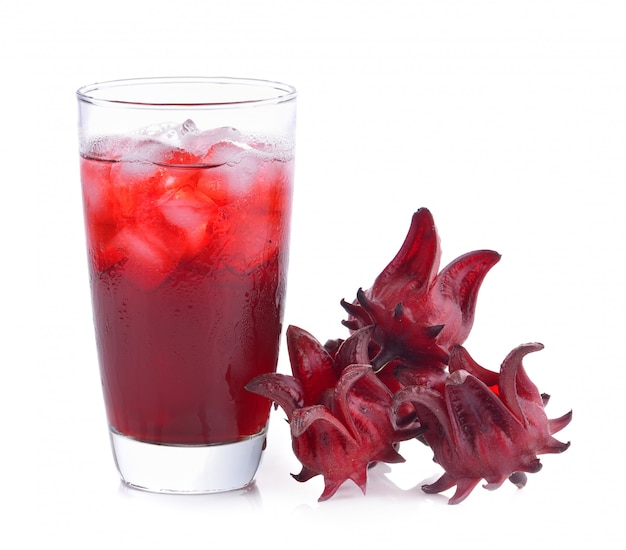 Roselle flower juice in glass with ice isolated