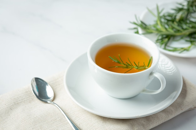 Rosemary hot tea in cup ready to drink