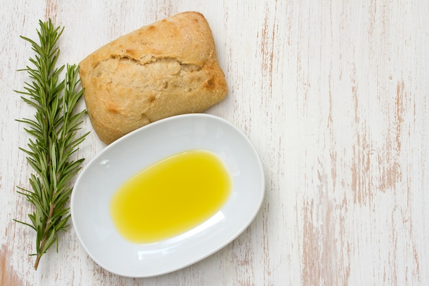Rosemary with oil and bread