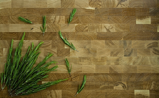 Rosemary on a wooden background.