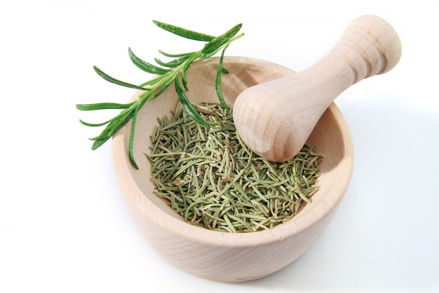 Rosemary in the wooden mortar