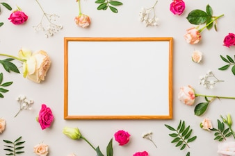 Roses and leaves around frame