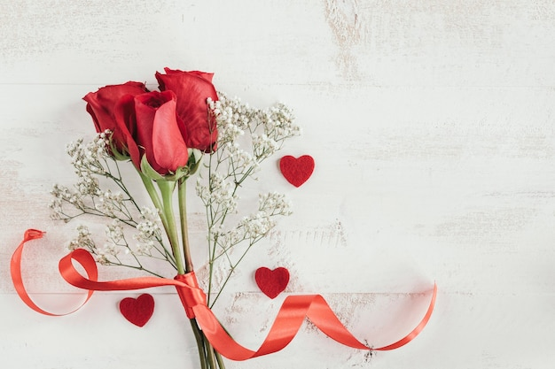 Roses bouquet and red hearts and blank space
