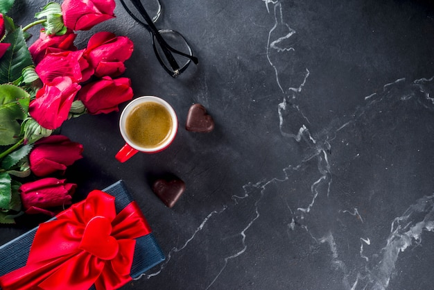 Roses, calculator, notebook and glasses on marble