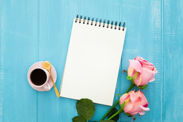 Roses, coffee and notebook